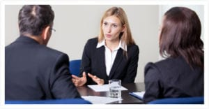 A Lawyer talking to two clients