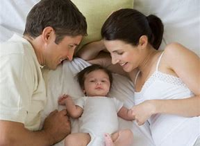 Photo of parents with a baby between them