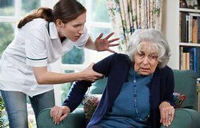 Woman aggressively grabbing elderly woman's arm