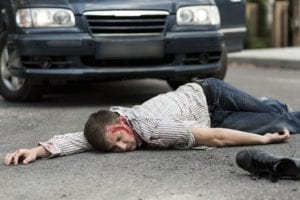 Photo of a dead man on the road after getting hit by a car