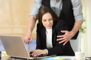 Image of woman being harassed at work